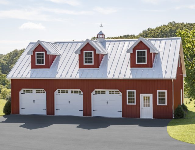 red and white metal three car garage