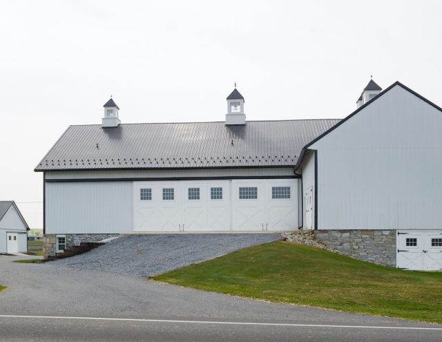 black and white detached agricultural barn
