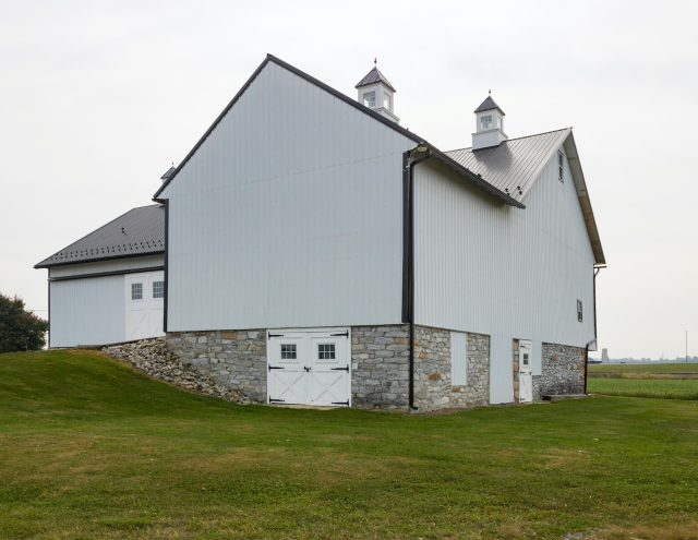 large stone and vinyl barn restoration