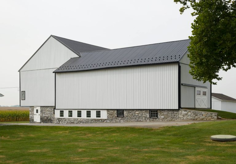 stone and metal sided barn restoration
